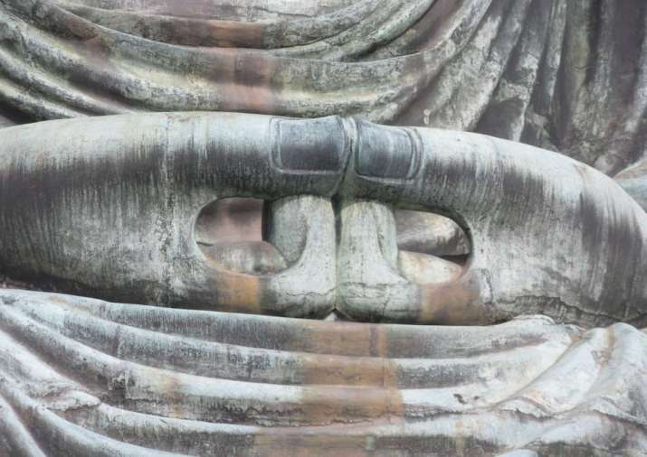 "Mida no join , a variation of the  dhyana mudra , meditation hand gesture of the Great Buddha at Kamakura. Photo by Meher McArthur. All rights reserved. From Meher McArthur, "" Stillness and Strength ,""  Buddhist Door , October 2, 2017. Permission pending."