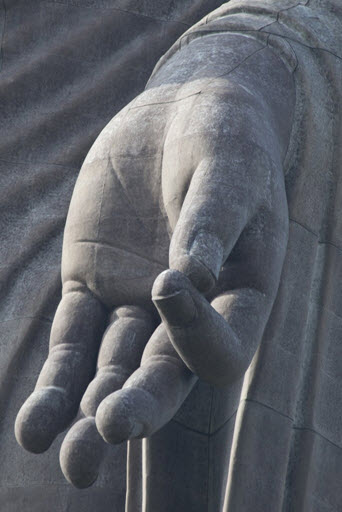 Left Hand.  Especially in Jodo Shinshu or Jodo Shu, the lowered left hand of Amida symbolizes not teaching but  giving , as well as  life  and  compassion . .