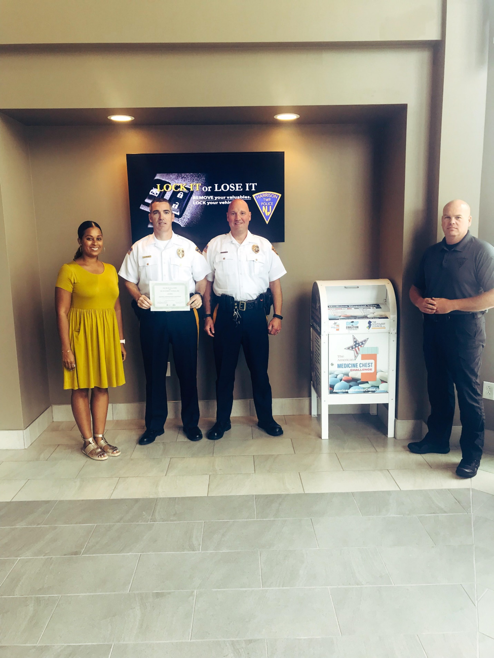Left to right: Candice Carter (GRASP Coalition);   Chief Thomas Mills (Harrison Township Police); Lieutenant Ronald Cundey (Harrison Township Police); D  etective Adam McEvoy ( (HarrisonTownship Police)