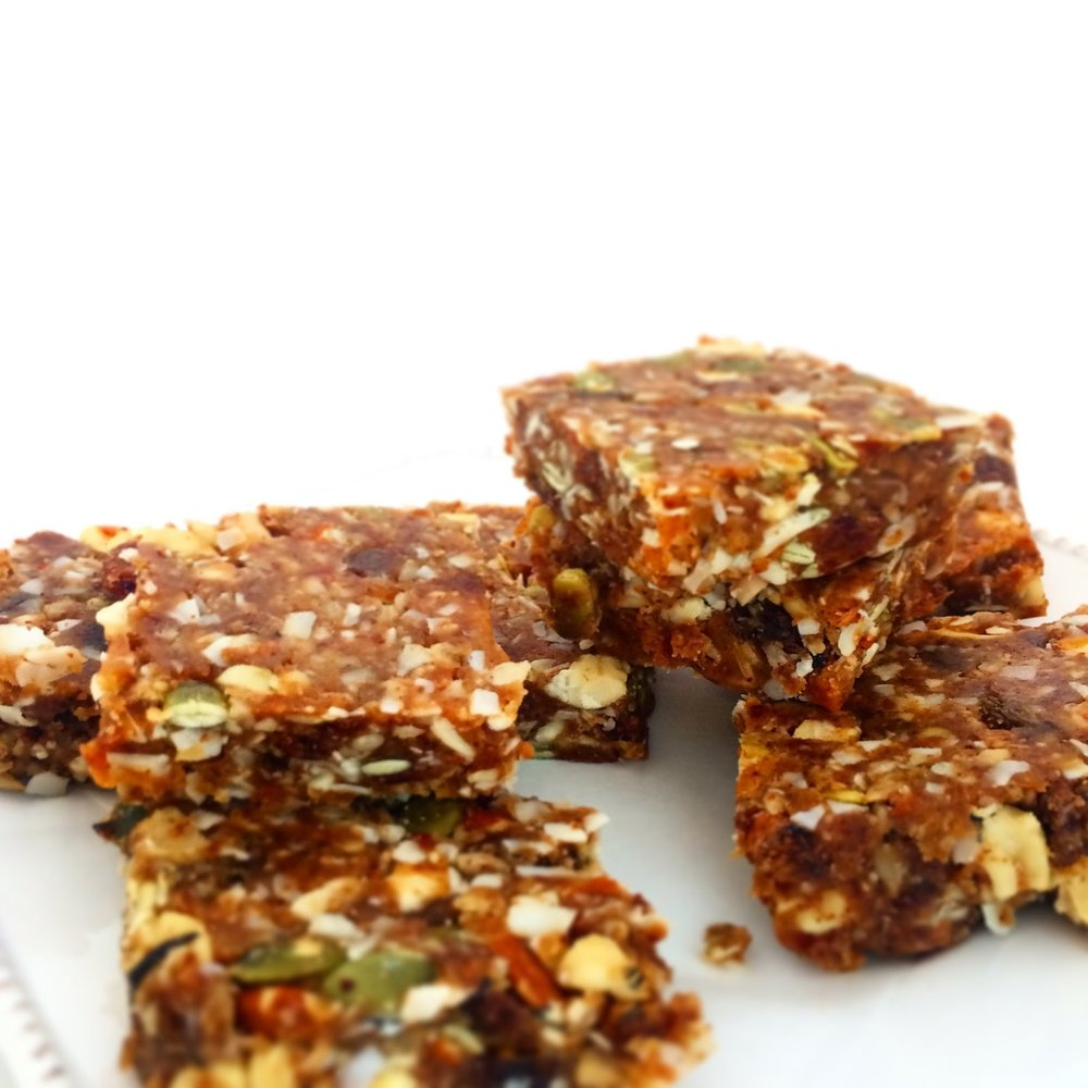Jojo Bar - Sweet & Savory Energy Bar $4.00 [2.5oz]Our golden energy bar is made with 100% sprouted organic nuts and seeds and sweetened naturally with mineral and nutrient-rich Algerian dates and smoked Vermont maple syrup. Imagine a perfect hike in the Green Mountains and that satisfying warmth of the campfire. This bar was made for life on the go, and life in the great outdoors. What does Jojo stand for? The Joy of Journeying Outdoors!Ingredients: Spanish sprouted almonds, organic Indian cashews, organic sprouted pepitas, organic sprouted sunflower Seeds, Vermont smoked maple syrup, organic chipotle chillies, roasted almond butter, organic house made almond meal, and pink Himalayan sea salt.