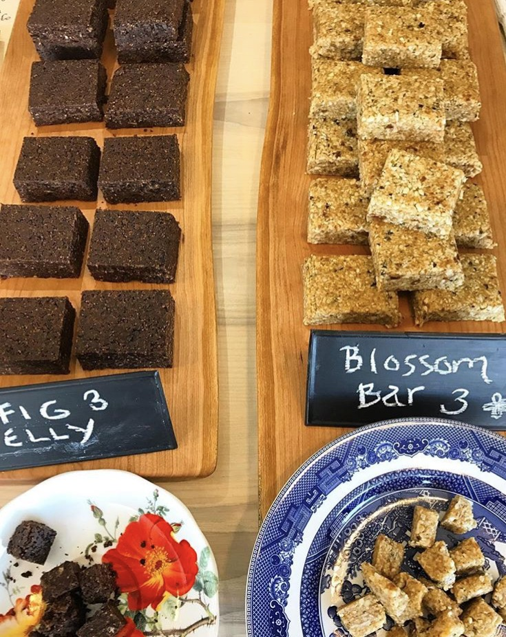 Blossom Bars & Fig Nellies - .75-2.5 oz Organic Sprouted Energy Bars & Bites: $1.00-$4.00Blossom Bars: Organic Hemp Seed, Organic Cashews, Organic Cashew Butter, Vermont Maple Syrup, Organic Shredded Coconut, Fresh Orange Peel, and Organic Algerian Dates, and Organic Coconut Oil. 100% Gluten Free Fig Nellies: Black Mission Figs, Organic Raw Cacao, Organic Almond Meal, Madagascar Vanilla Bean, Organic Coconut Oil, Vietnamese Cinnamon. 100% Sugar Free and GF