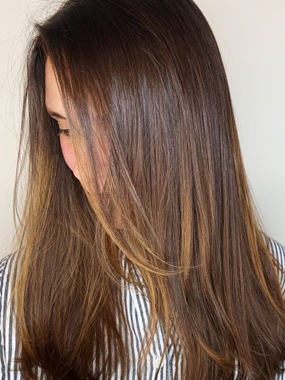 Glossy warm balayage on a client   Schedule Here