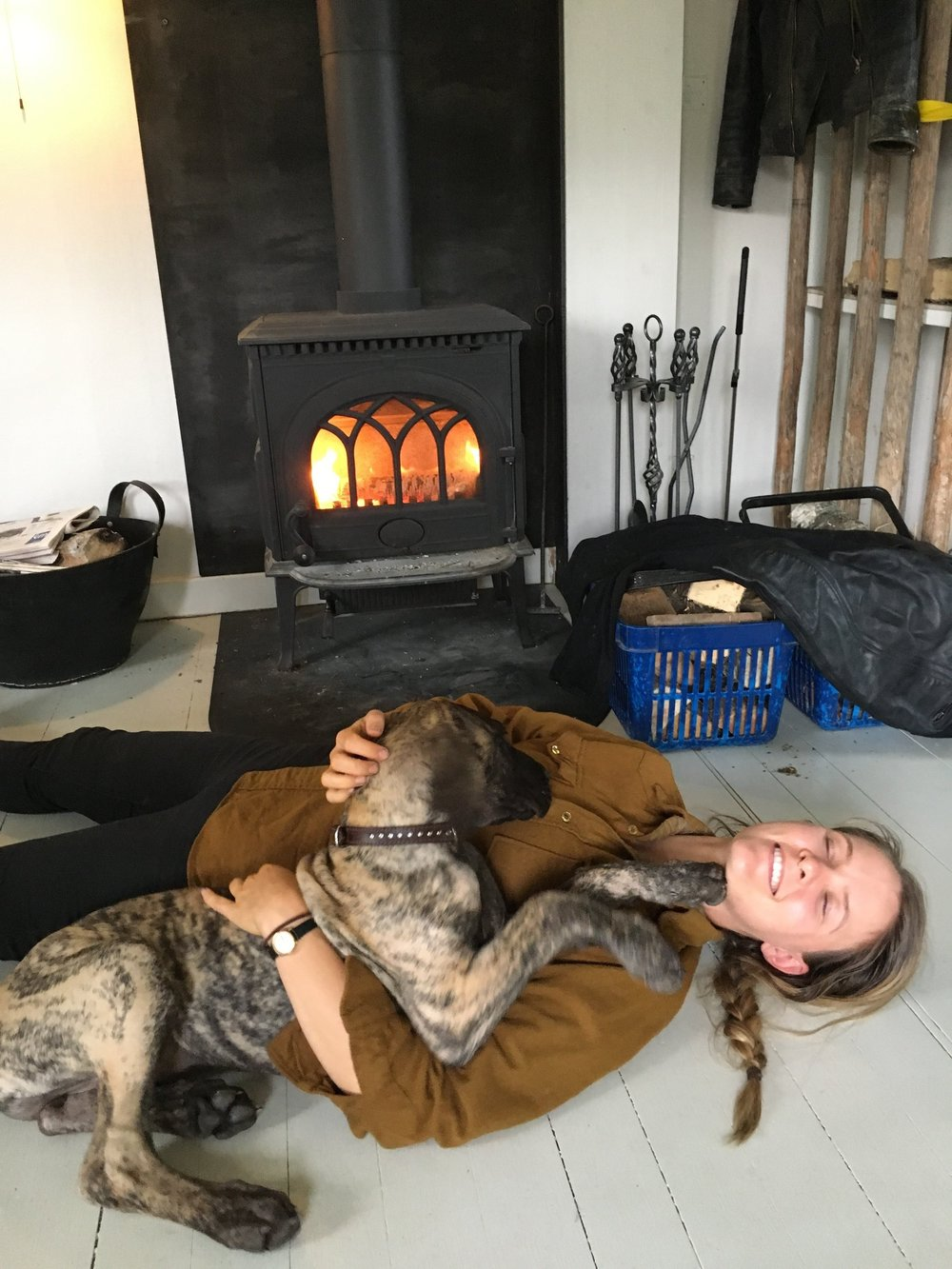 Warming up and drying off by the fire with Nova