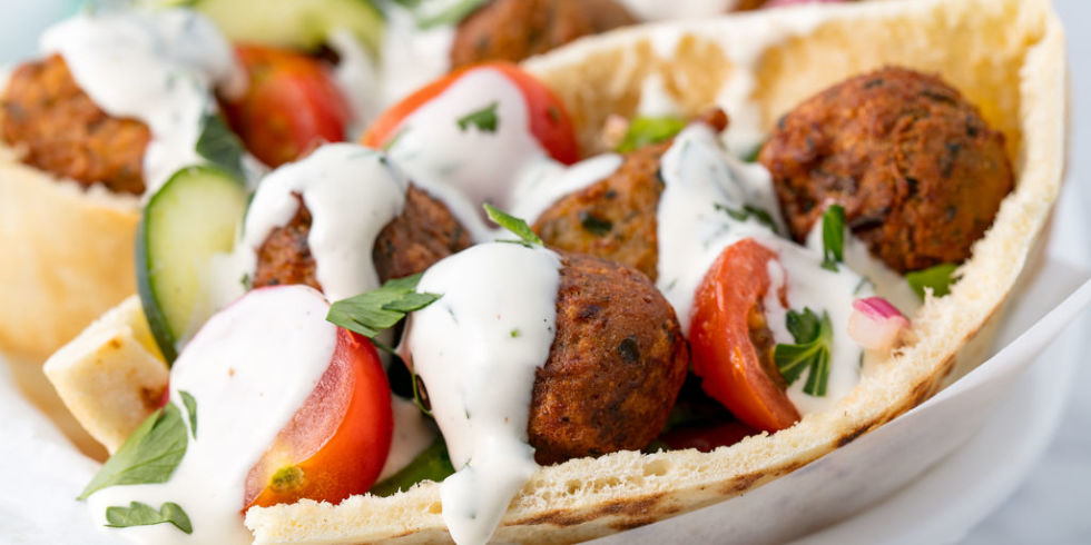Falafel Pita  - I loooove Falafel, and this recipe is so easy to modify for the whole family. Each person can build their own. I substitute the falafel with roasted or rotisserie chicken for my son and add hummus or tahini. I serve it with rice and a salad on the side. Tip: If you don't have time to make falafel from scratch Trader Joe's sells frozen falafel that is ready to heat and serve.