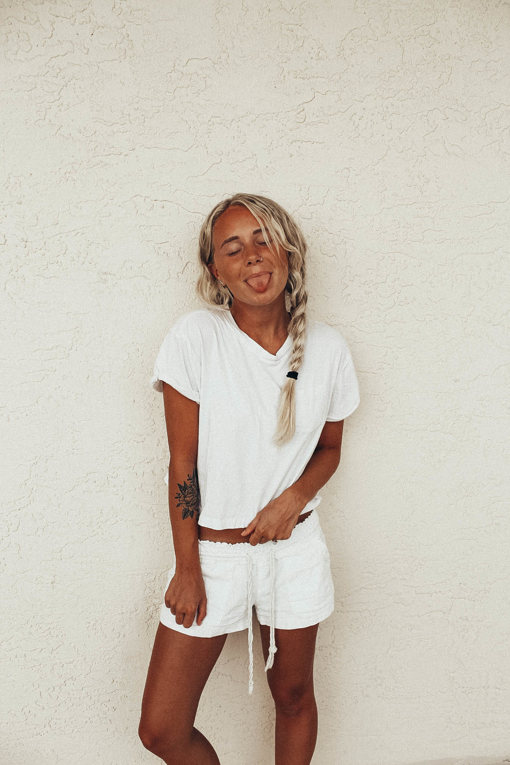 I'm a major fan of a nice all white comfy beach outfit.   These  shorts  are ROXY brand, my  white crop top  is from H&M.