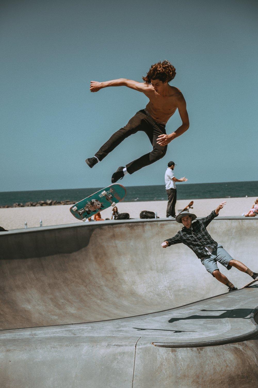 Teenager skateboarding on the Venice Beach Boardwalk