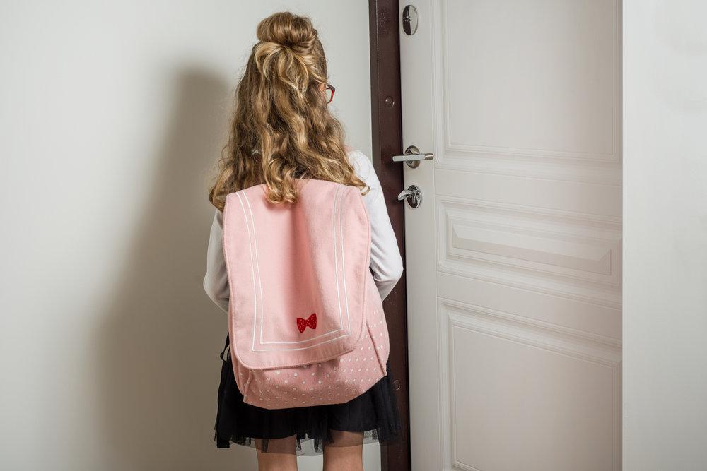 girl opening door in Los Angeles