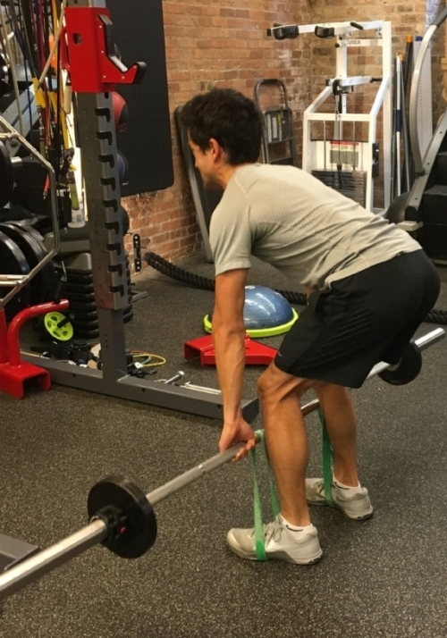 Strength training with band resistance to stimulate neural activation.