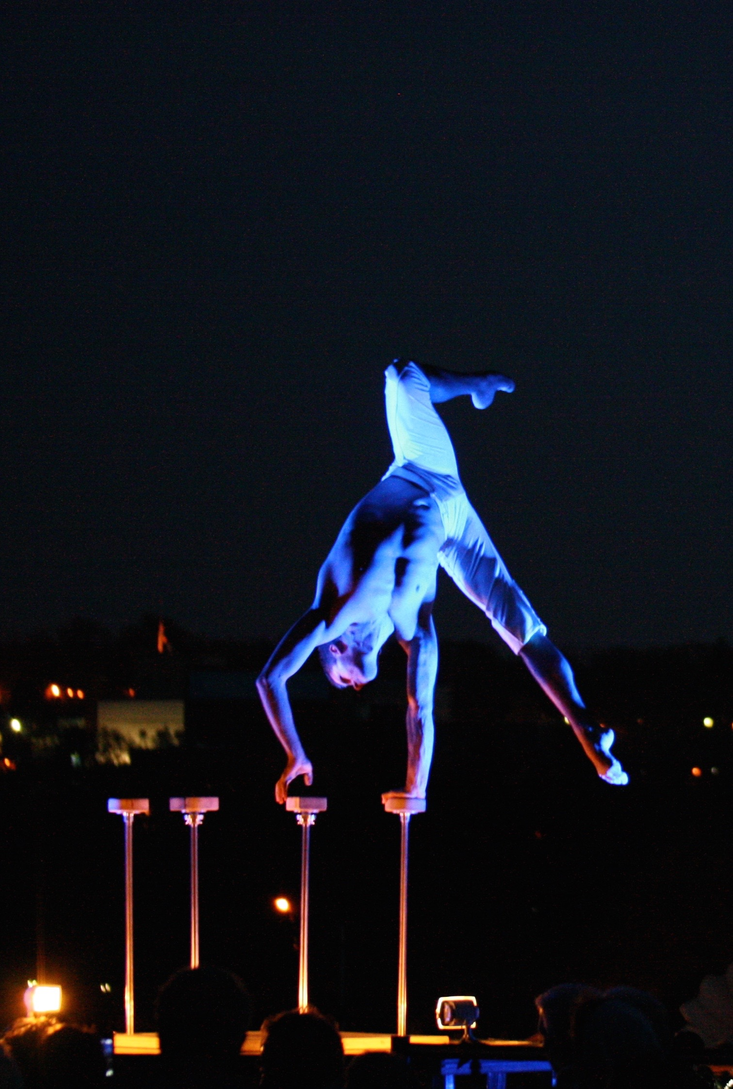 A Quixotic Fusion performer stretches above the treetops of Kansas City.