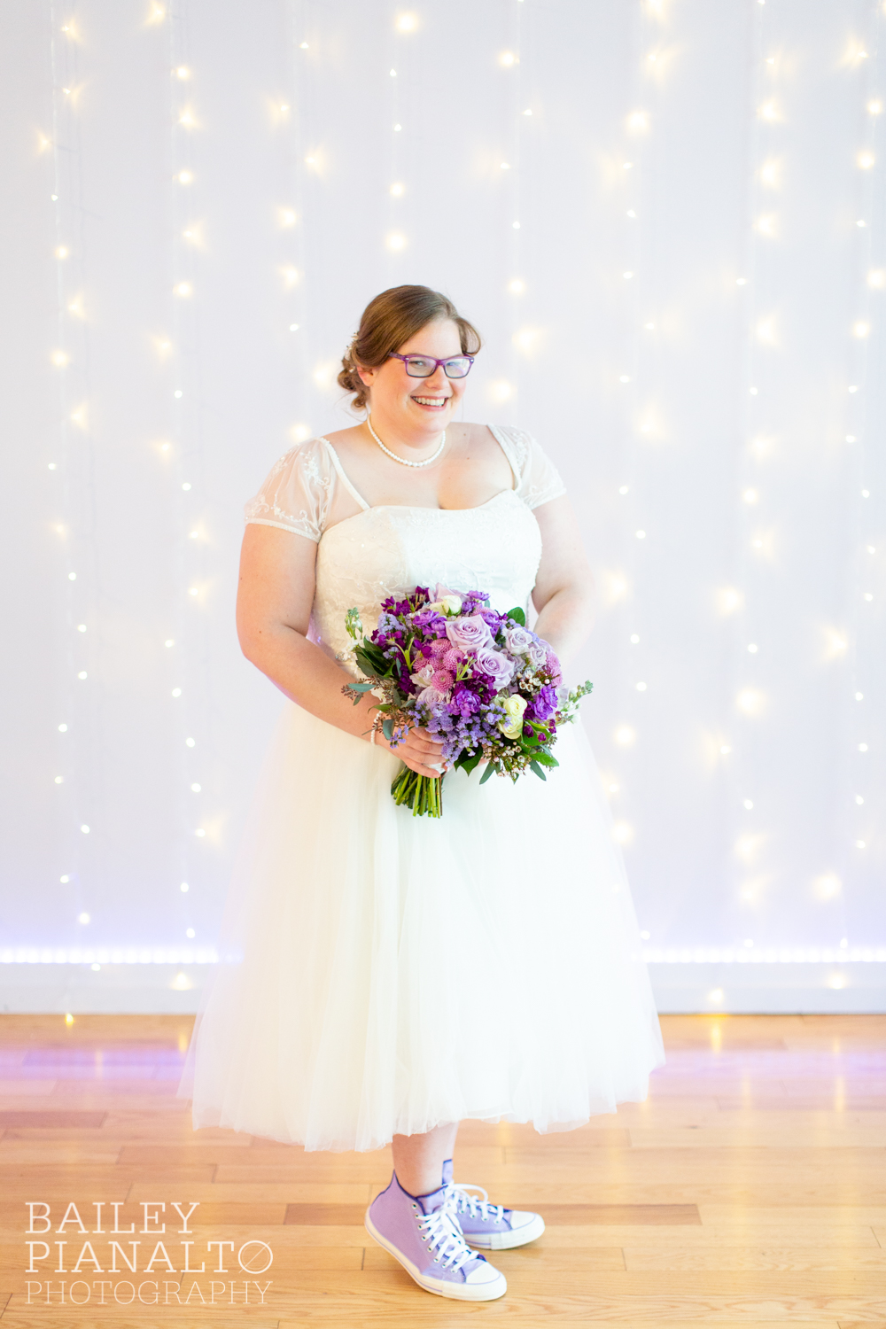 Bride Getting Ready at Purple & Gray Down-to-Earth Spring Wedding with Heart + Soul Floral and Converse All Stars    Uptown Theater   Kansas City, MO