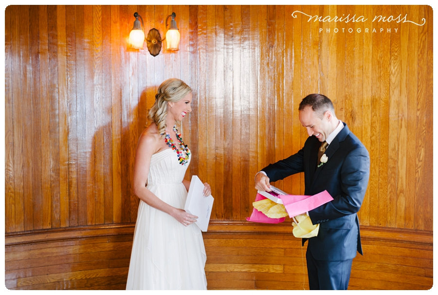Groom opening boudoir book gift on wedding day, perfect wedding day gift! Photo by Marissa Moss