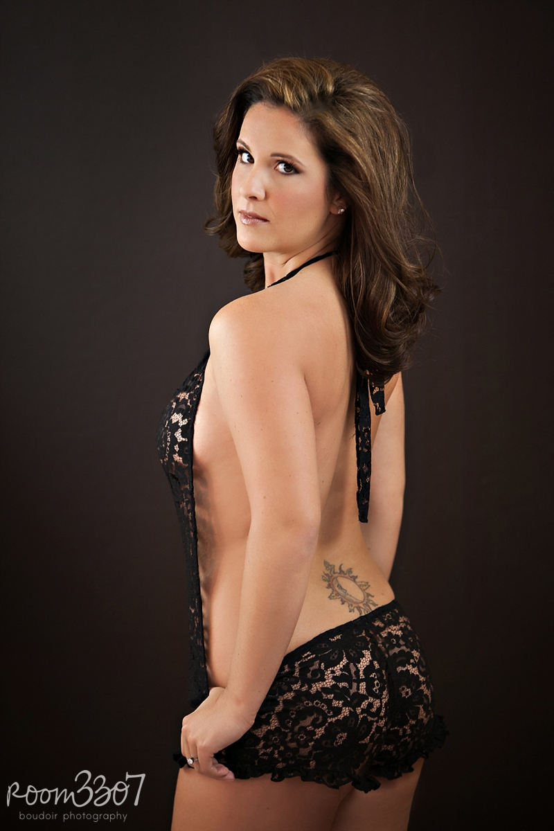 Black lace Zinke romper, boudoir photo shoot by Room 3307 boudoir photography in Tampa, FL.  Hair and makeup by Jess Waldrop makeup artists