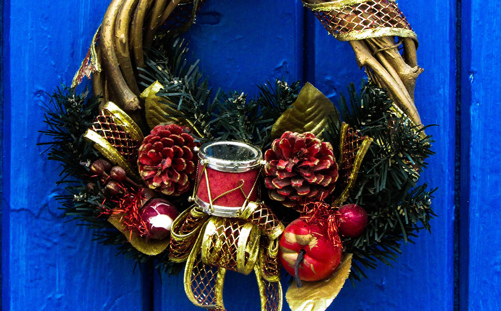 festive christmas wreaths with fruits, pinecone and a drum