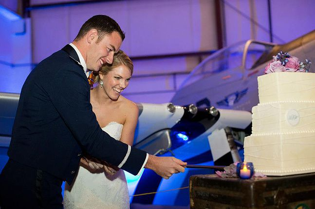 Our cake stand was Will's great grandfather's trunk from WWII, and we cut the cake with an Air Force saber. Photo:  Chris Isham Photography
