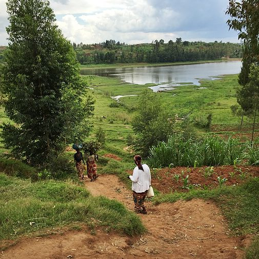 Picture: Genia and the co-op walking to their water source. They do everything in community.