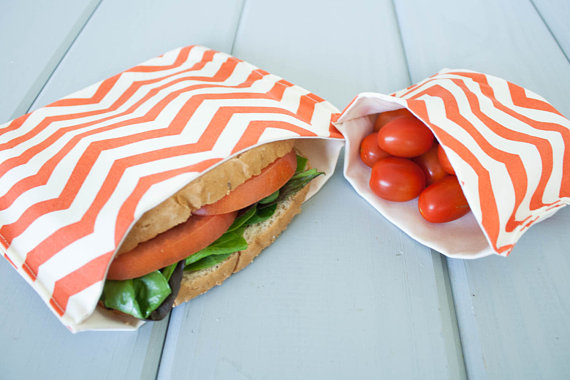 """This set of two bags from the Etsy shop  Island Picnic  is perfect for carrying a sandwich and a snack. The inside is made out undyed, unbleached organic cotton sateen protecting your food from dangerous chemicals. We love that the company's tag line really is: """"Yup, It's All Organic!"""""""