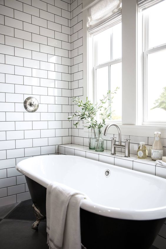 Jonna Gaines makes gorgeous bathrooms that don't need shower curtains! The question is whether we'd miss a shower too much!