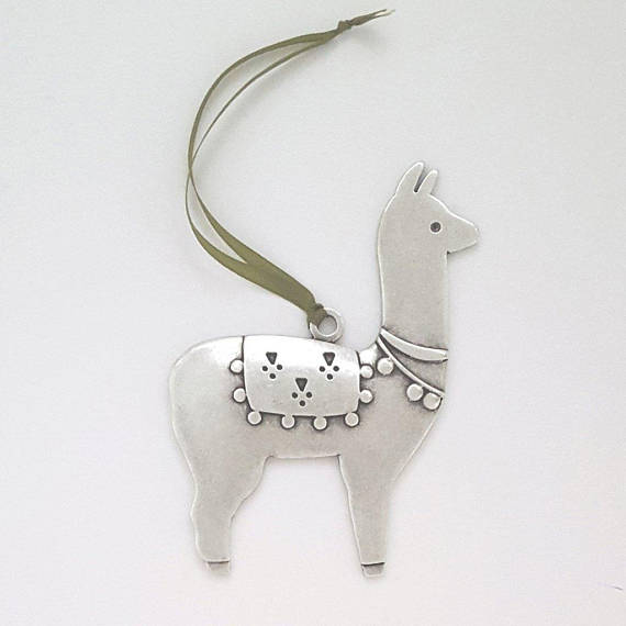HANDMADE.  This llama holiday ornament is decked out in traditional finery to help deck the halls, and spiff up your tree. We think he's quite irresistible! Hand cast in lead-free pewter. 3.5 inches tall  $24