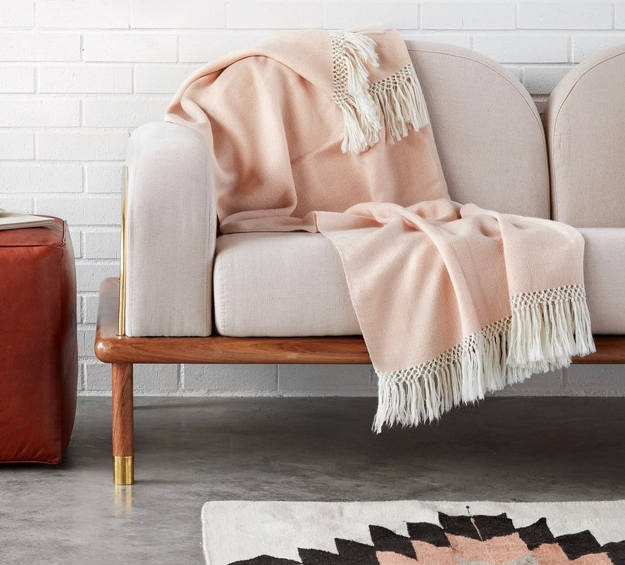 FAIR TRADE. HANDMADE.   Hand-loomed using an old-world technique of concentric diamond patterns, this  baby alpaca throw  is incredibly soft. Featuring a dusty blush hue and knotted fringe, it's as beautiful as it is warm and cozy.  Handcrafted by master weavers in a quiet mountain village in the Peruvian Andes, each throw takes about a week to complete. All made exclusively in a fair trade environment.  Note: Alpaca wool is hypoallergenic, so this throw is ideal for those with allergies or sensitive skin.  $135