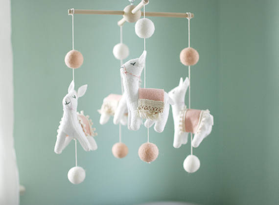 HANDMADE.  This sweet mobile features happy llamas with blush pink blankets and natural lace. Llamas are made out of highest quality wool blend felt and filled with hypo allergenic fiberfill. No unsafe buttons, the eyes and noses are embroidered with cotton floss.  Fully hand cut and sewn.  $95