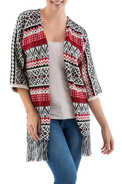 HANDMADE.  Peruvian Artisan Wilber Calapuja designed this original long cardigan with a rare three-quarter length sleeve and a flirty fringe.  100% Alpaca  132.99