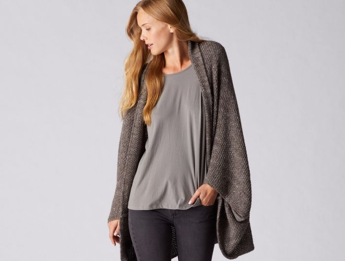 Part sweater, part cardigan, you'll fall in love with this irresistibly soft and warm wrap. The fiber is sourced from small, sustainable ranches in the mountains of Peru and left undyed to showcase the natural beauty and variation of alpaca.  $298