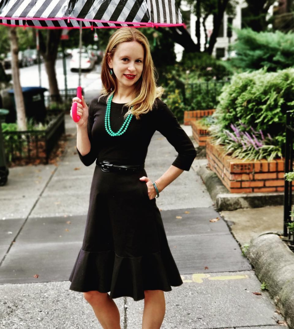 Rebecca Ballard, the founder of the Maven Women, is on a mission to create clothes that truly let women shop their values and feel confident! She's wearing a Maven Women dress, bracelets from @theants, and a necklace and vintage faux leather belt from @etsy.