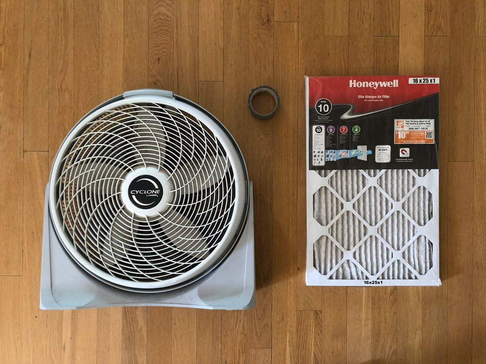 All you need to make your own DIY air filter for smoke and smog is (1) a fan (any fan) (2)) an air filter (any size… even one you already have on hand for your furnace or AC), and (3) some strong tape, or, in a pinch, even a cord or twine. You simply attach the filter to the fan to force air through it to be purified.