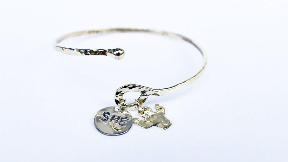 The SHE Thrives Bracelet - a collaboration between Lucy + Jo and SHE Changes Everything