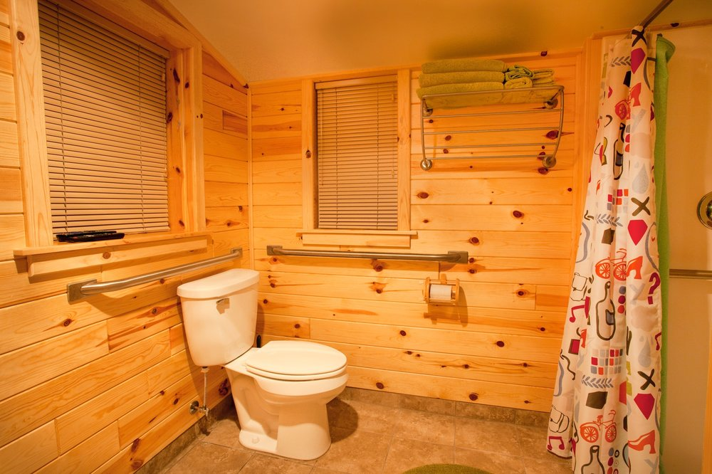 A great handicap accessible bathroom, clean, neat, bright and spacious.  Check out the cool paper holder, it is the little extras that make a stay here so sweet.  No need to bring towels, wash clothes, sheets or linens, they are all here for your comfort.
