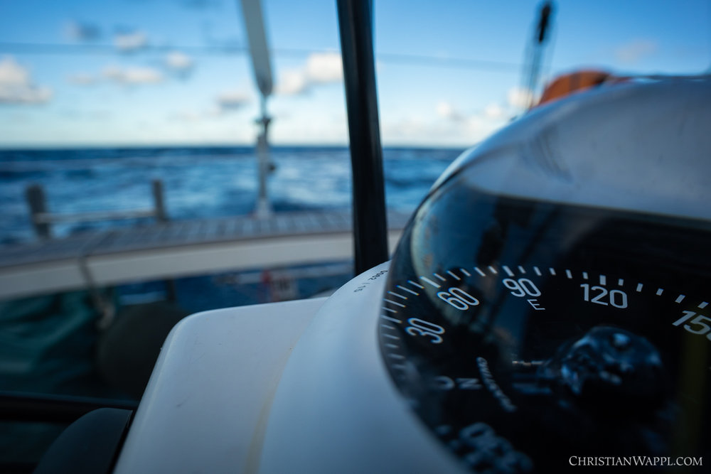 One of many compasses on board