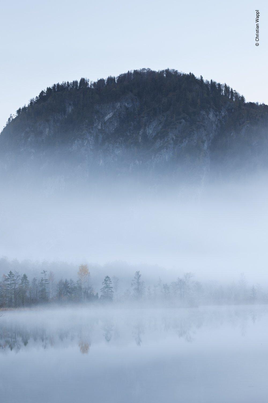 Misty morning on an alpine lake