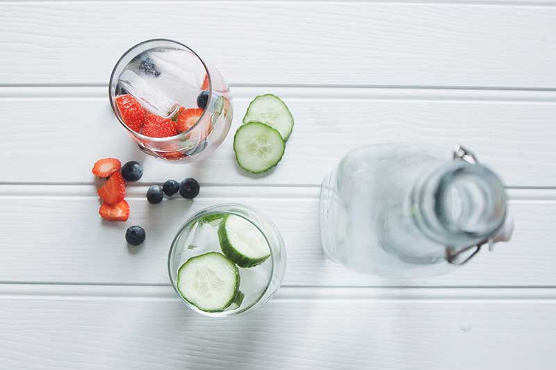 glasses-of-water-with-cucumber-and-berries.jpg