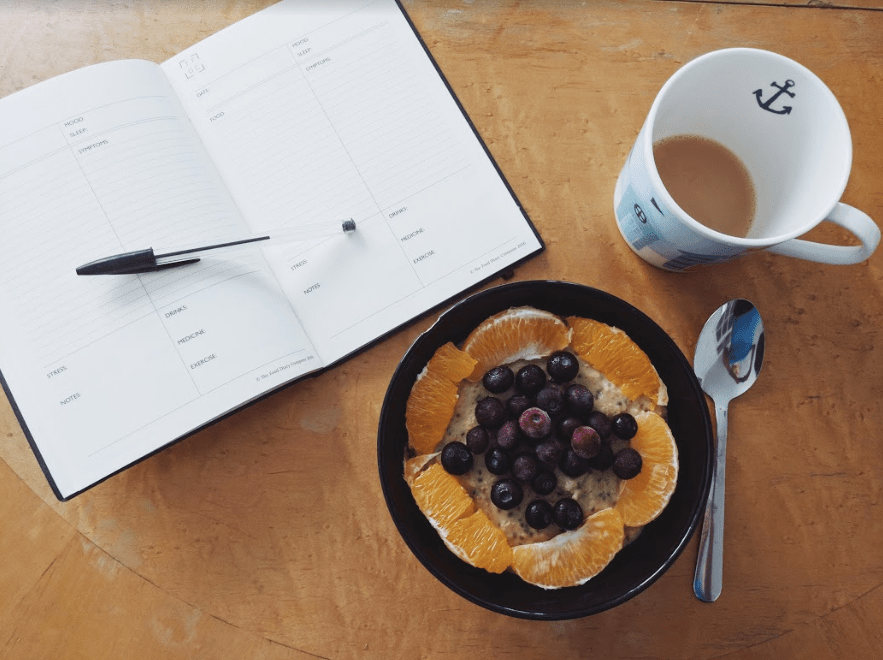 health-food-diary-on-table-with-bowl-of-porridge.png