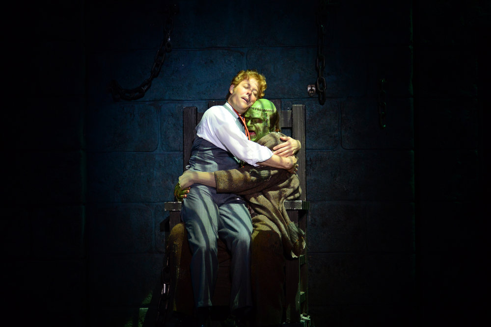 2013_OP_Young-Frankenstein_John-Bolton_as_Frederick-Frankenstein_Brad-Nacht_as_The-Monster_hug_photo-by_Gary-Ng_RGB.jpg