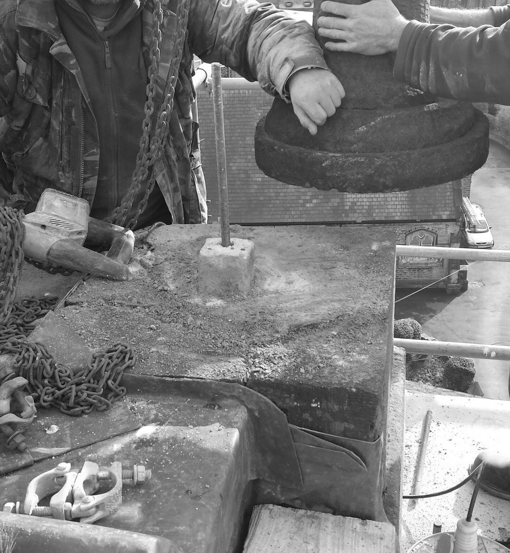 Copy of stonemason at high level on church tower