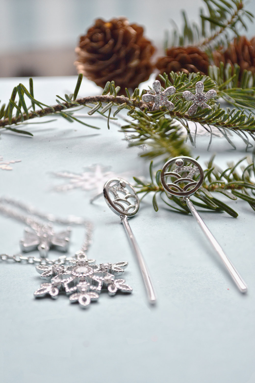 Holiday creatives from AcePicked's sterling silver jewelry line.