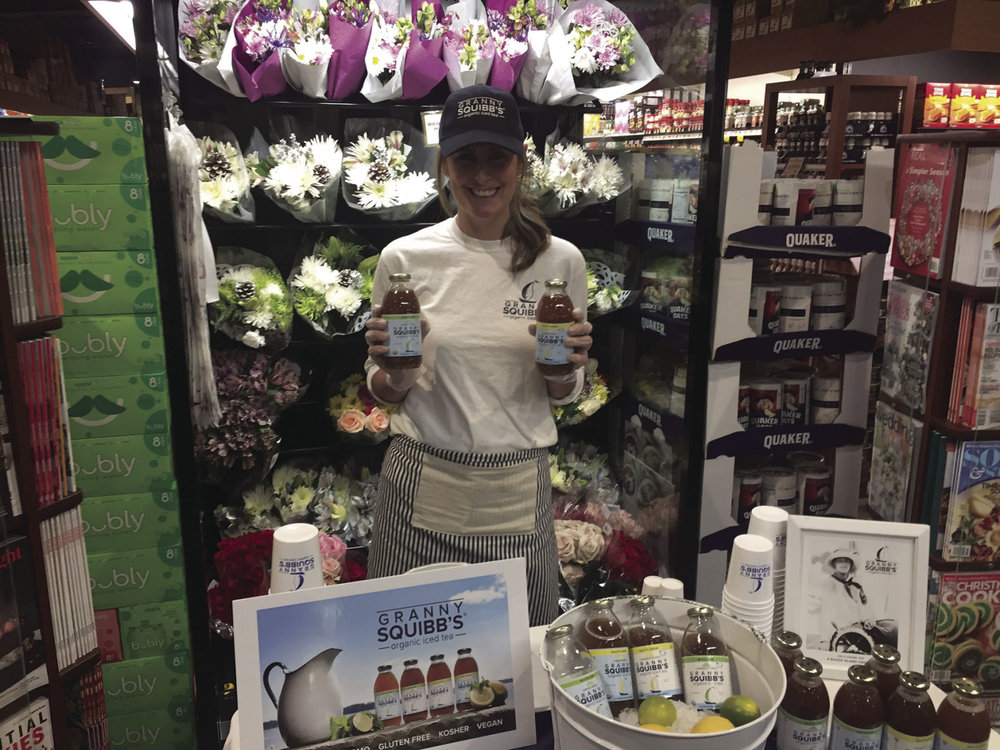 Partner Kelley McShane at Dave's Market with North Kingstown Standard