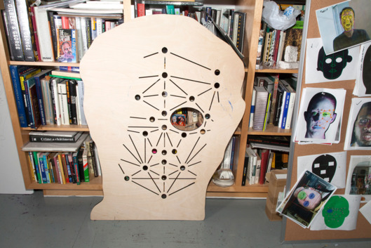 A template of facial recognition points and documentation for Oursler's current exhibition.    Photo: Sarah Trigg