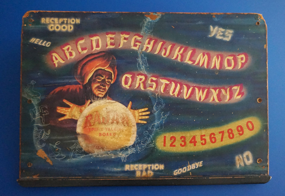 "One of Oursler's Ouija boards. Collecting Ouija boards, he said, ""is a pretty highly competitive thing,"" but he has a few."