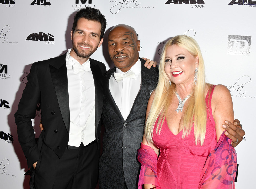 Monika Bacardi and Andrea Iervolino with their special guest Mike Tyson at AMBI Gala: Cinema to change the world