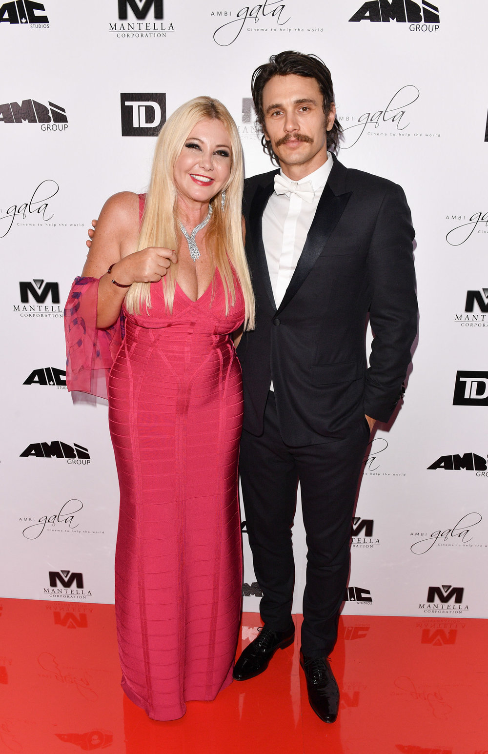 Monika Bacardi and co-chair James Franco on the red carpet for AMBI Gala 2016