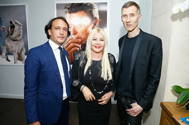 "Monika Bacardi, David Kane and the photographer Markus Klinko at exposition ""David Bowie Unseen de Markus Klinko"" in Artcube Gallery in Paris"