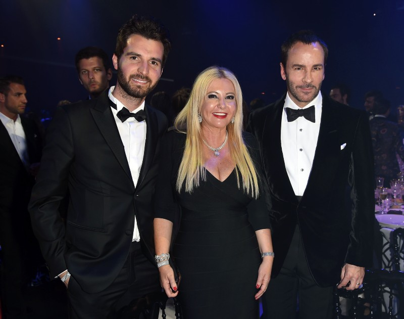 Monika Bacardi with the fashion designer Tom Ford and her business partner Andrea Iervolino at amfAR Gala Cannes 2015