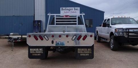aluminum.flatbed.bolinger.inc.5th.wheel.hitch.angled.corner.jpg