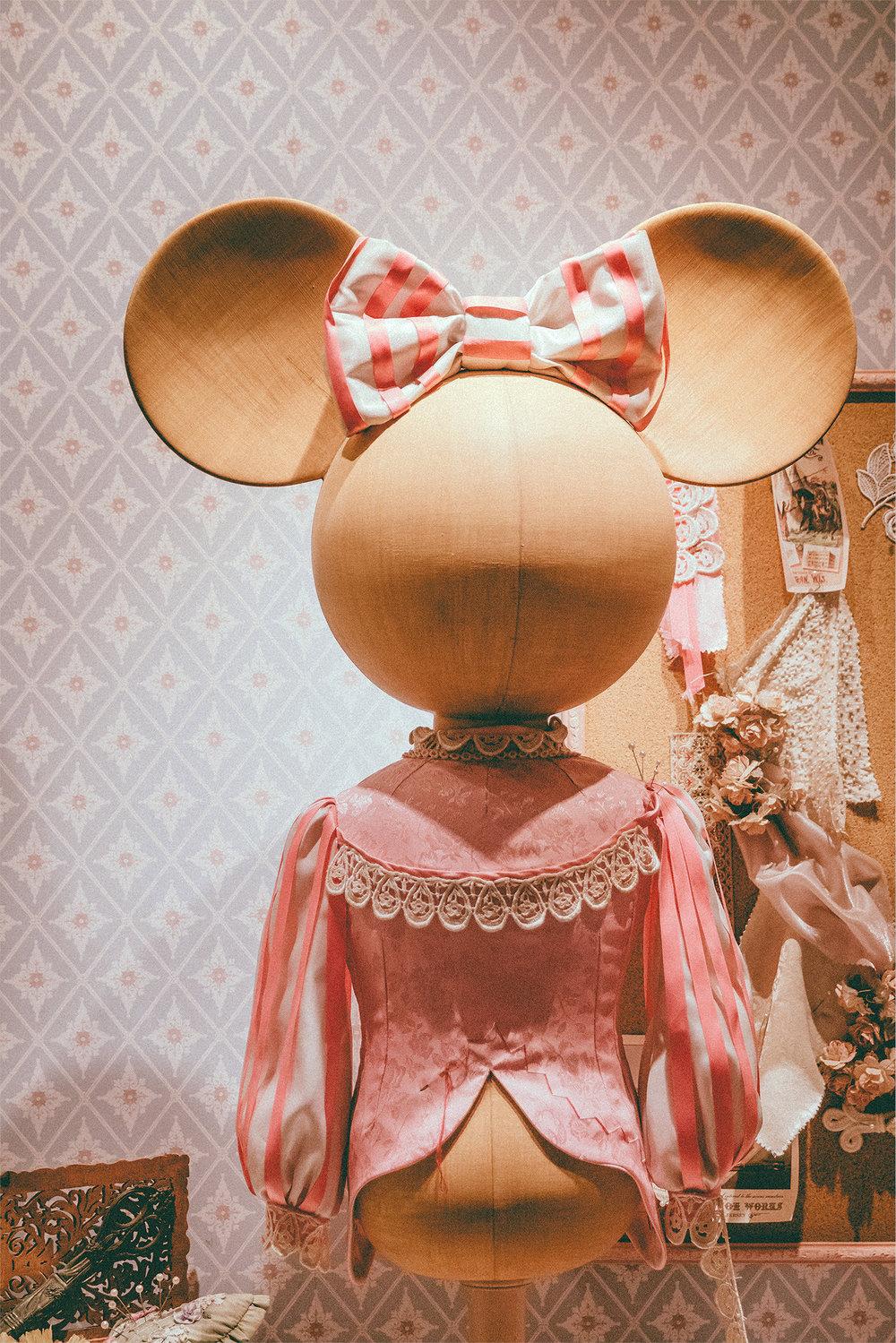 In World Bazaar, Minnie is a seamstress for Disney royalty.