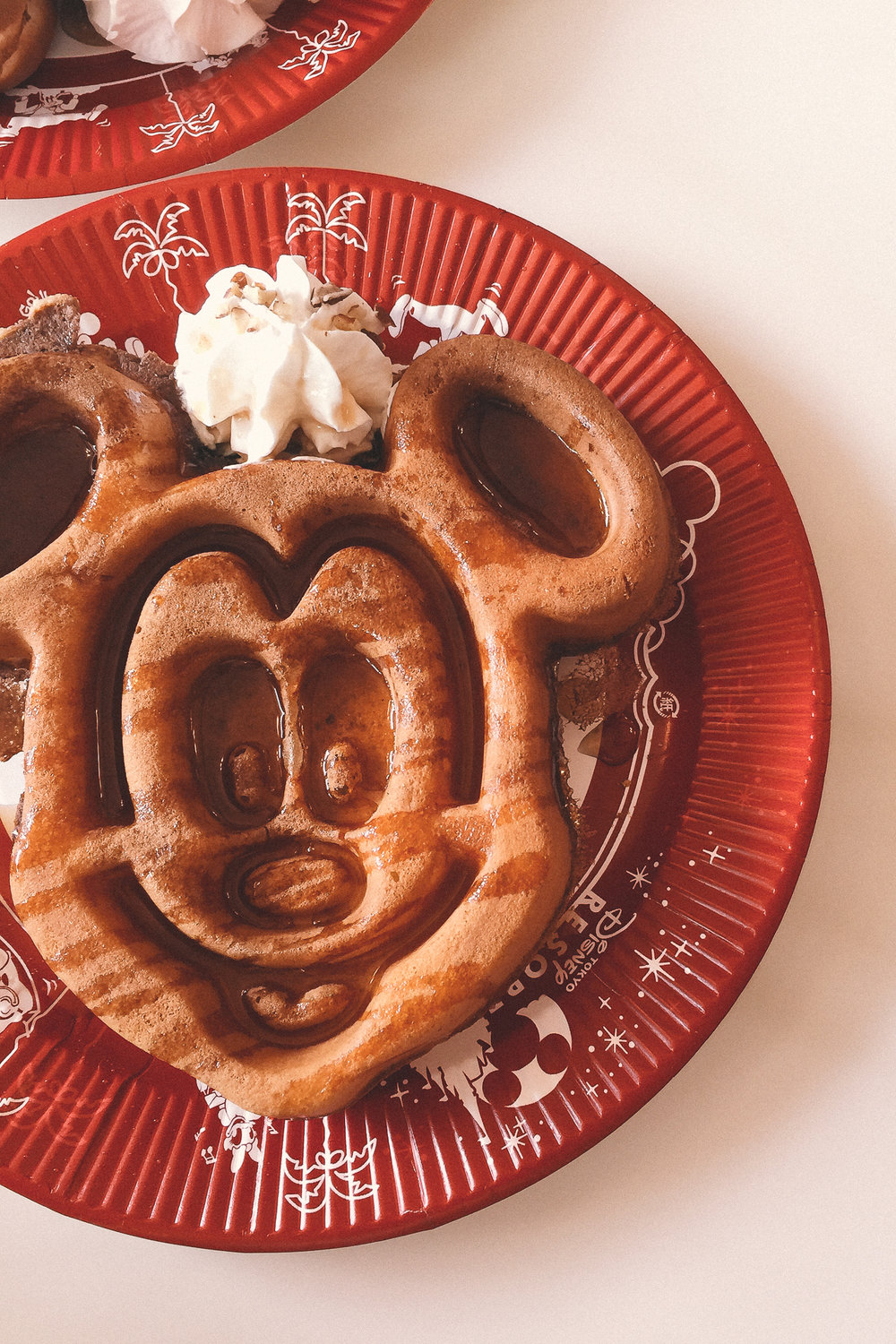 Mickey Mouse Waffle from the Great American Waffle Company  (¥450) While Mickey waffles can be found at all the Disney resorts worldwide, here at Tokyo Disneyland you can enjoy delightful toppings like strawberries & custard or red bean & matcha. It's a great way to start your day,especially if you're too busy chasing characters to eat a proper meal. If you have a moment,  watch the Cast Members prep  the waffles because it's quite amusing.