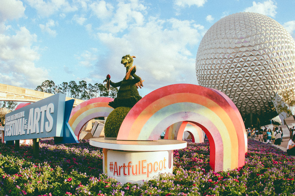 Maybe I'm a bit bias, but the Festival of Arts has the best main entrance display I've ever seen at Epcot. 🌈