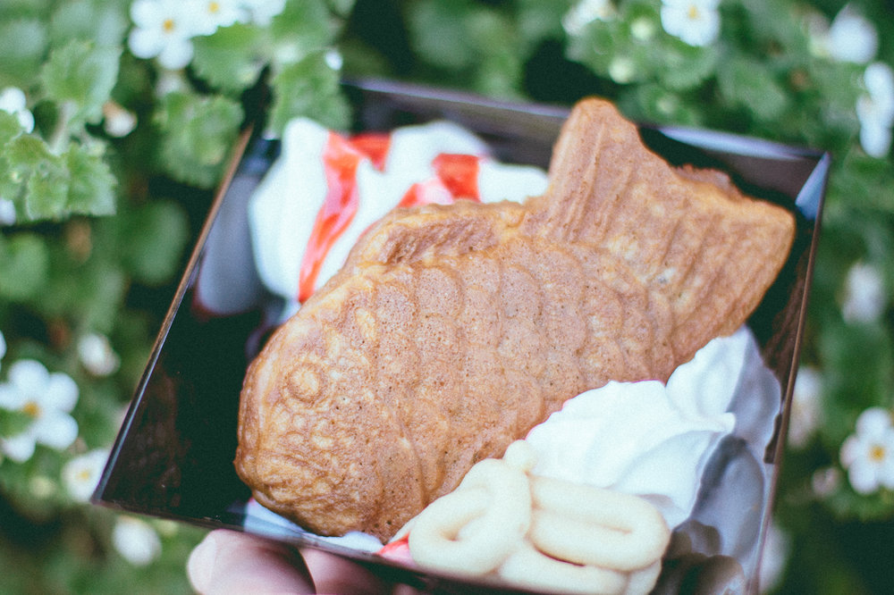 Taiyaki Dessert from  Takumi Table  - 3.5/5 Taiyaki is a traditional Japanese treat that is either sweet or savory. The one from Epcot is sweet with red bean filling, sesame cream, and a raspberry sauce. I was really excited to try this out, but wasn't too happy that they drowned the poor fish in so much whip cream. The quality, overall, wasn't as outstanding as the kind you'd get from an actual Japanese street vendor.