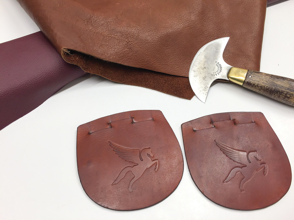 Italian Calfskin Leather in Cognac Colour and buckle guards with Paramount logo